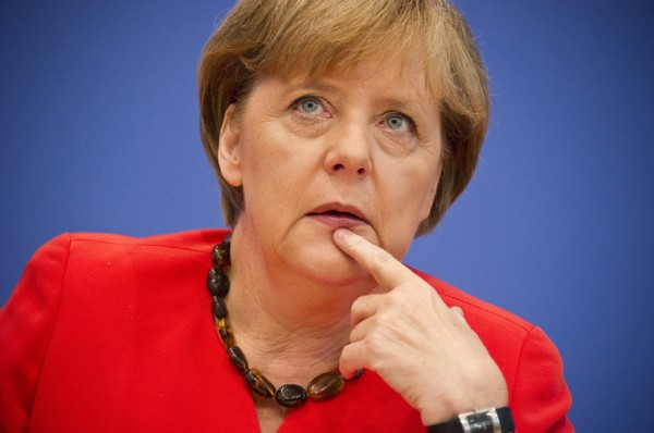 Меркель: Германия должна осуществить обязательства перед НАТО