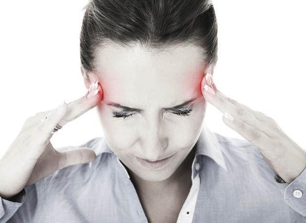 Эксперты: Лишний вес может стать причиной мигрени
